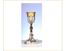 Chalice of silver with liturgical elements in relief