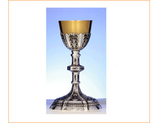 Chalice of silver with a foot, the knot and cup chiseled