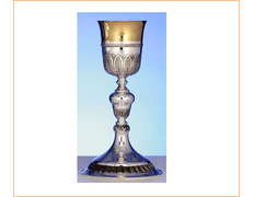 Chalice of silver with a circular base and knot of acorn