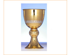 Chalice of silver with chiselled and simple bathroom golden