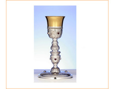 Chalice of silver chiselled with stones