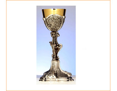 Chalice of silver asymmetrical with liturgical elements, chiseled