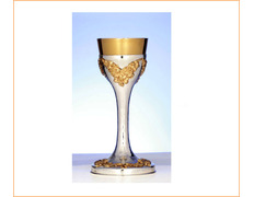 Chalice of silver's smooth with bunches of grapes gilded