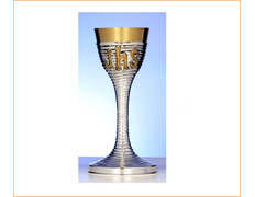 Chalice of silver with JHS golden