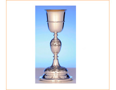 Chalice of silver with knot and base chiseled