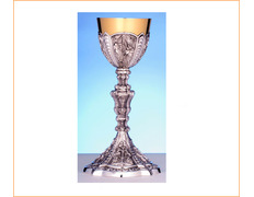 Chalice of silver gothic with grapes in relief