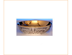 Paten made of embossed silver with inner gold