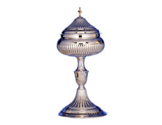 Ciborium of silver, carved with golden Cross