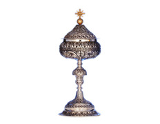 Ciborium of silver with elements in relief and gilded Cross