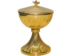 Ciborium made of metal decorated with wavy lines