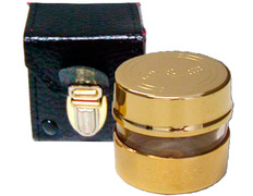 Chrism of golden metal with leather case