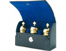 Three crismeras gold plated with case